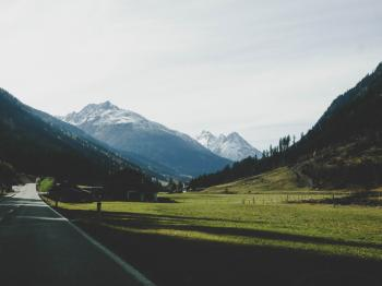 Landscape Photography of Mountains Near Road