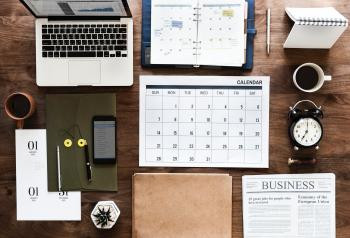 Laptop,, Calendar and Books