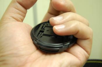 Lens cap in hand