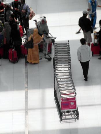 Line of Airport Luggage Trolleys