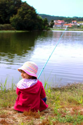 Little girl fishing and smiling
