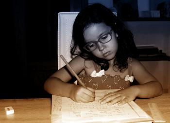 Little Girl Focused On Doing Homework