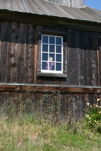 Little Girl in a Window in a Fort