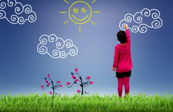 Little girl painting the sky - Child joy and happiness concept