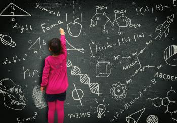 Little girl writing on blackboard