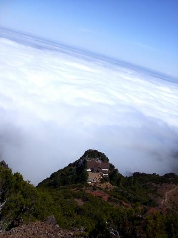 Lodge in the mountain above clouds