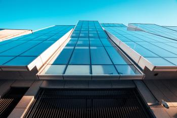 Low Angle Photography of Blue Glass Building