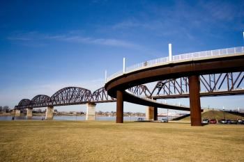 Low Angle Photography of Brown and Gray Bridge Under Blue Calm Sky