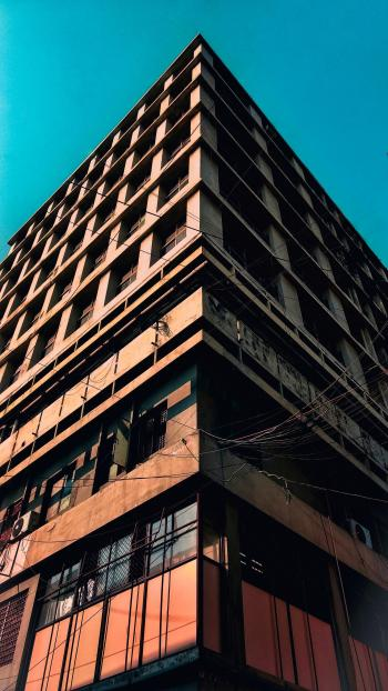 Low Angle Photography of Brown Concrete Building
