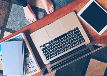 Macbook Pro Besides White Ipad on Table