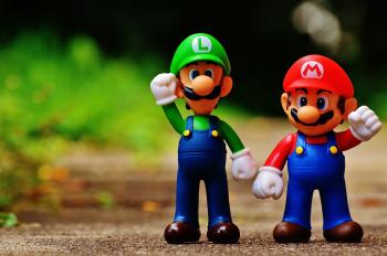 Macro Photography of Mario and Luigi Plastic Toy