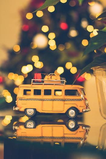 Macro Shot Photography of Brown Volkswagen Van Figure on Table
