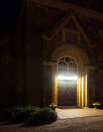 Main entrance Brastad Church at night 3