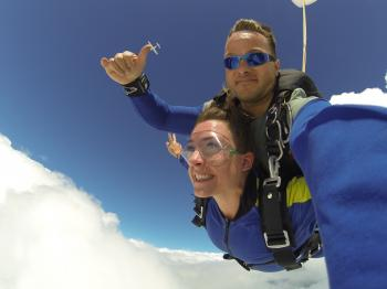 Man and Woman in Blue Jacket Doing Sky Diving