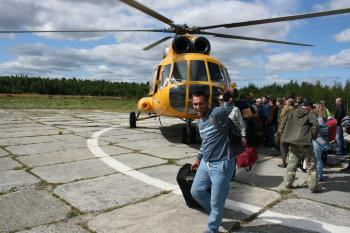 man arriving on helicopter