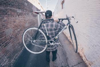 Man Carrying White And Black Bianchi Road Bike