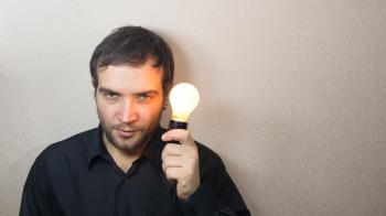 Man holding light bulb