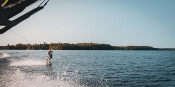 Man Holding Parachute With Wakeboard