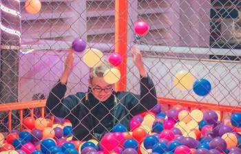 Man in Ball Pit