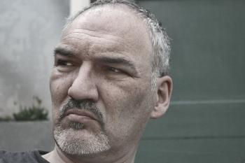Man in Black Shirt Near Gray Wall