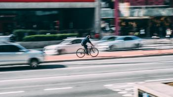 Man in Black Shirt Using Black Road Bicycle