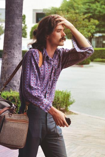 Man in Blue Button-up Long-sleeve Shirt
