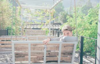 Man in Gray Shirt Sitting on Bench