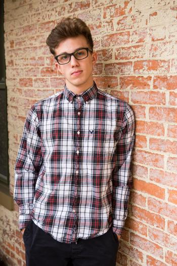 Man In Plaid Dress Shirt And Black Pants Wearing Eyeglasses