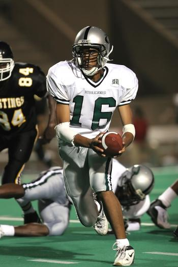 Man in White 16 Football Jersey While Playing Football