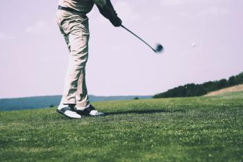 Man in White Denim Pants and Black Sandals Playing Golf during Daytime