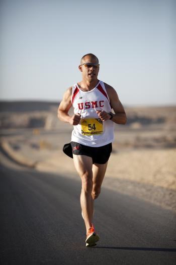 Man in White Jersey While Running