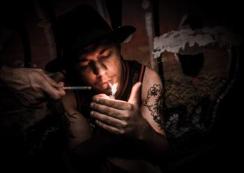 Man Lighting Cigarette
