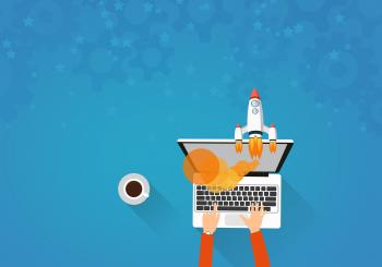 Man on Laptop and Rocket Launching