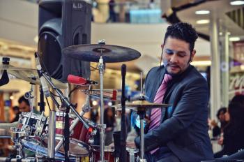 Man Playing Drum Inside Mall