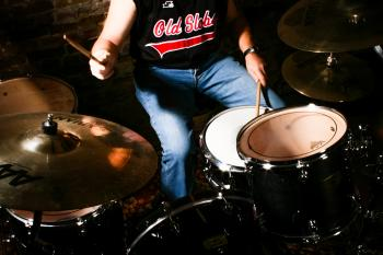 man playing drums instrument