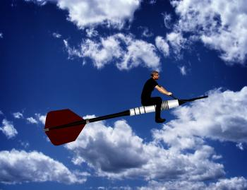 Man riding a dart through the sky