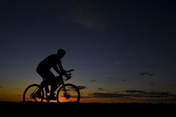Man Riding Bicycle during Nightfall
