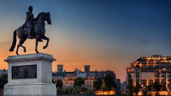 Man Riding Horse Sculpture