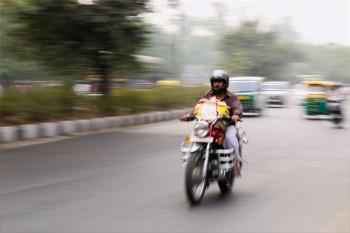 Man Riding on Motorcycle