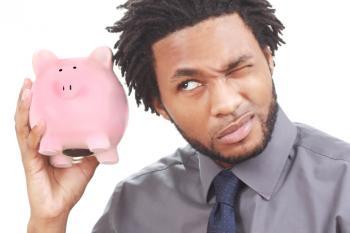 Man shaking a piggy bank
