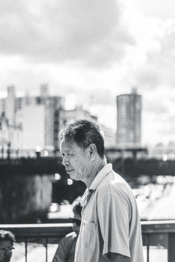 Man Sitting in City