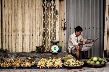 Man Sitting Near Fruits