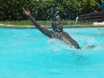 Man Splashing in the Swimming Pool