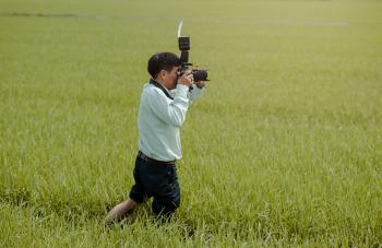 Man Taking Photos in the Field