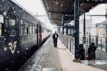 Man Walks Beside Train