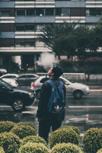Man Wearing Black Jacket And Blue Adidas Backpack