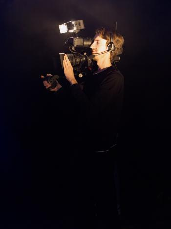 Man Wearing Black Long-sleeved Shirt Using Video Camera