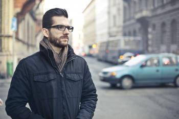 Man Wearing Black Zip-up Jacket Standing on the Street