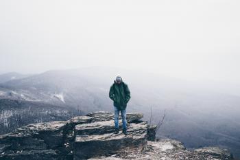Man Wearing Green Full Zip Snow Jacket