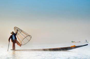 Man Wearing Jacket Riding Canoe